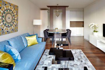 Ένα πολυτελές μικρό διαμέρισμα με ένα έξυπνο και κομψό πάσο-τραπέζι-νησίδα-διαχωριστικό, σίγουρα απλό, απόλυτα κυριλέ και φουλ οργανωμένο.